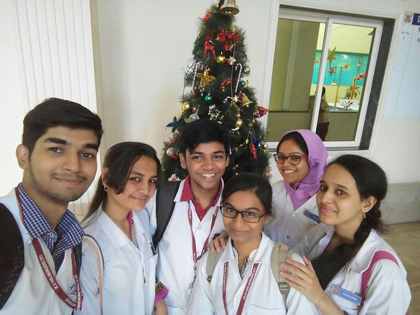 THESE Are My Friends in my Dental college with freinds with our christmas tree..!