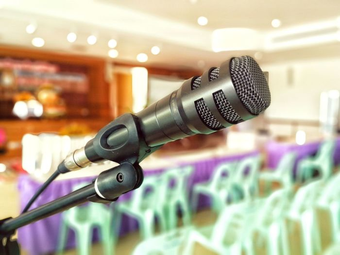 Close-up of microphone at conference
