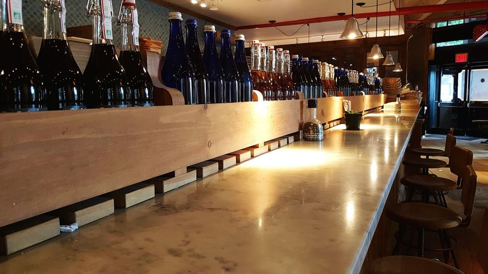 New York City Food and Drink indoors restaurant restau Leading Lines New York City Food And Drink Indoors  Restaurant Restaurant Interior Design Night Restaurant Decor No People Bottles Collection Bottle Bar Countertop Illuminated