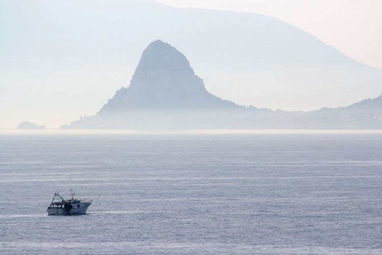 Misty Sicilian Shore Nautical Vessel Water Transportation Mode Of Transportation Mountain Sea Scenics - Nature Day Sky Tranquility Travel Outdoors