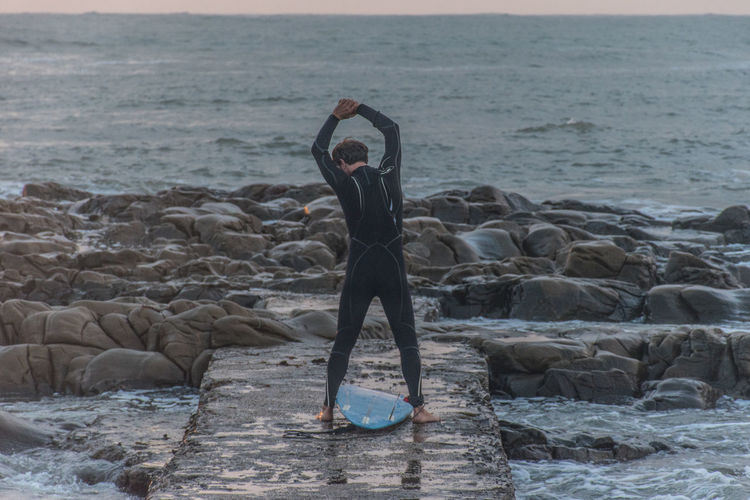 Let's Go Surfing Sea Water Horizon Lifestyles Real People Motion Leisure Activity Human Arm Beach Surf Surfer Aloha Board Surfboard Seascape Sunset Style And Sport Muta Wharf Civitavecchia, Italy