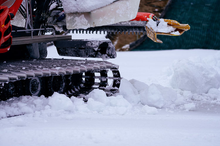 Close-up of snow cat preparing ski slope