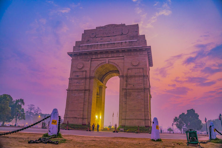 Low angle view of monument at sunset