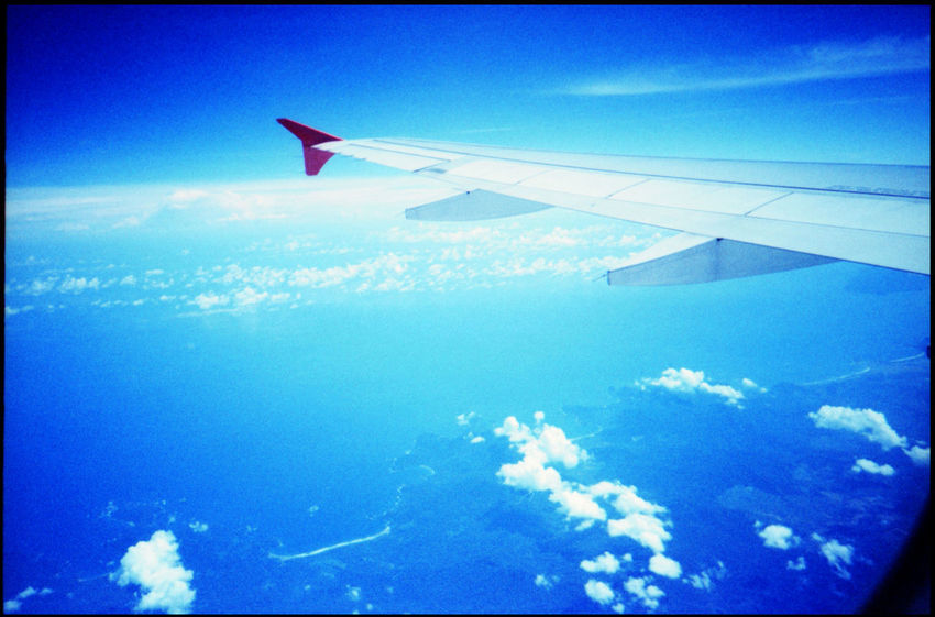 The perks of flying ASIA Air Asia Analogue Photography Flights INDONESIA Jakarta Lomography Plane Wings Travel Airline Blue Sky And Plane Dramatic Skies In The Air Flight Flying Plane In The Clouds Plane Over City Plane Porn Plane Spotting Plane Window Stewardess Up In The Air Wings Xpro
