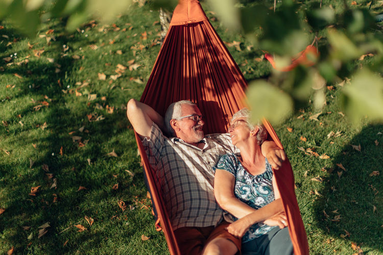 Senior couple bonding on the hammock. free time together. positive retired people.