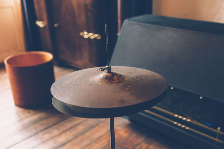 high angle view of an old cymbal Cymbal Hi-hat Drums Drum Musical Instrument Home Decor Vimtage Design Music Close Up High Angle View Indoors  No People Close-up Still Life Metal Household Equipment Focus On Foreground Wood Domestic Room Day Home Absence Drum Kit Parquet Analogue Sound