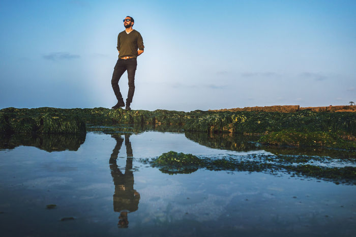 Adventure Business Finance And Industry Day Full Length Hanging Out Human Lake Lifestyles Loneliness Men Nature One Person Outdoors People Puddle Real People Reflection Sky Standing State Of Mind  Strength Success Travel Water Young Adult Lost In The Landscape Be. Ready.