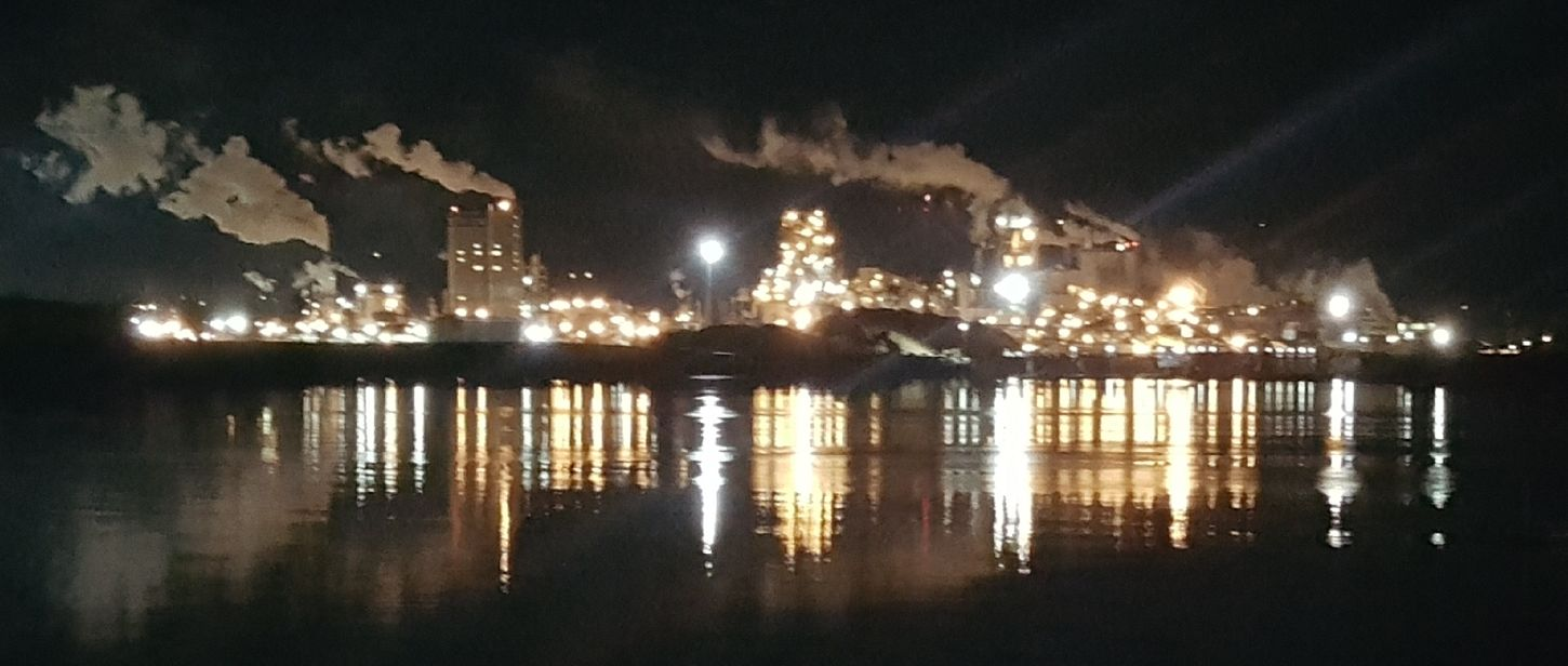 Longview Fibre mill. taken from the Rainier, Oregon side of Columbia River. Industrial Water Reflections Illuminated