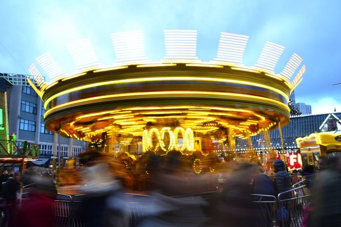 Amusement Park Amusement Park Ride Carousel Illuminated Arts Culture And Entertainment Blurred Motion Merry-go-round Built Structure Outdoors Night Carousel Horses Sky Architecture Building Exterior No People An Eye For Travel Mobility In Mega Cities Colour Your Horizn