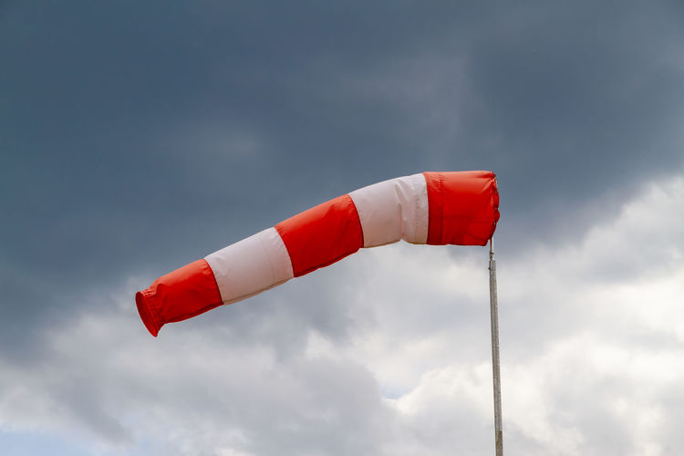 Windsock on a stormy day Dark Global Warming Service Sign Storm Weather Windsack Aircraft Wing Airport Climate Climate Change Cloud - Sky Clouds Danger Ecology Forecast Measure Measurement Meteorology Nature Orkan Safety Sky Weather Report Windsock