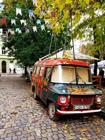 Mode Of Transport Street Land Vehicle Tree Day No People Old City City View  Rustic Charm Cubblestone City Lifestyles Travel Destinations Red Color Old Car Old Van Car EyeEmNewHere Let's Go. Together.