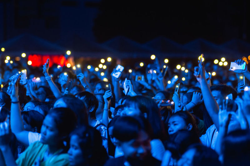 Crowd at music concert at night