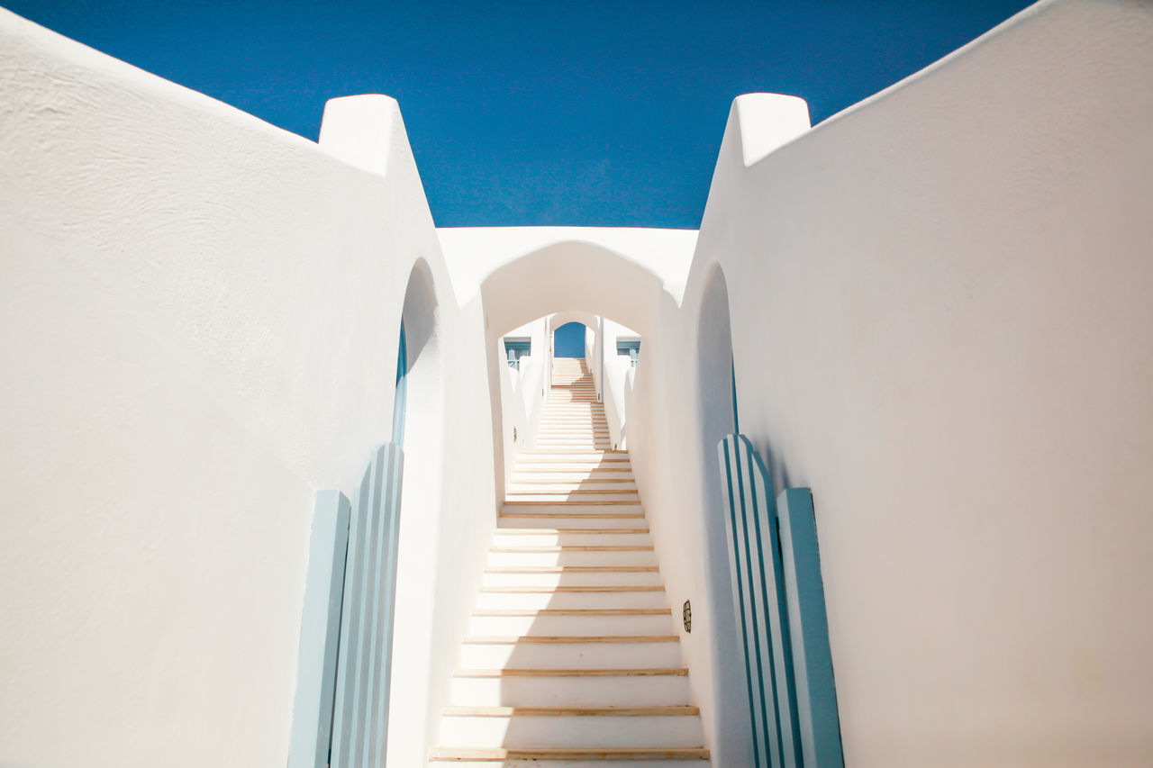 Low angle view of whitewashed stairway at santorini