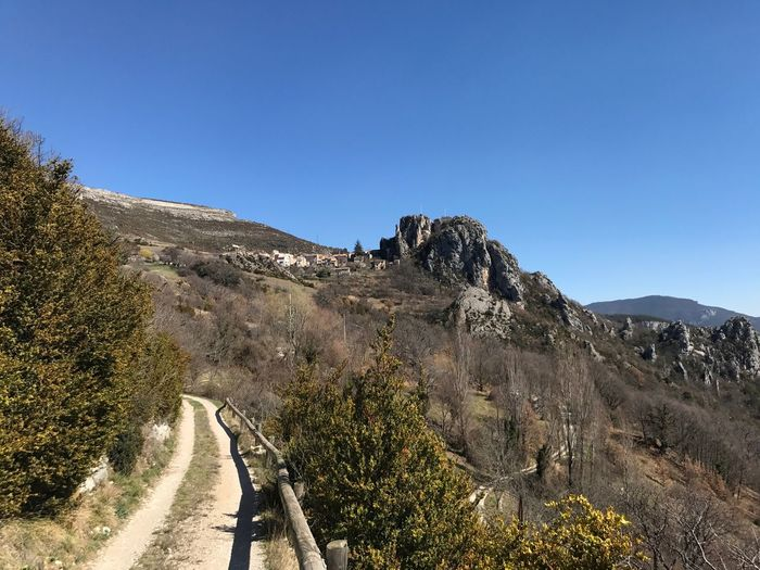 Rougon Clear Sky Copy Space Blue Mountain Beauty In Nature Nature Day Scenics The Way Forward Outdoors Tranquility Tree Winding Road Road No People Mountain Road Landscape