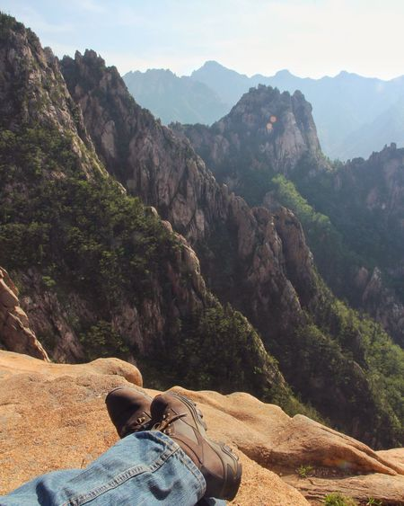 Low section of man against rocky mountains