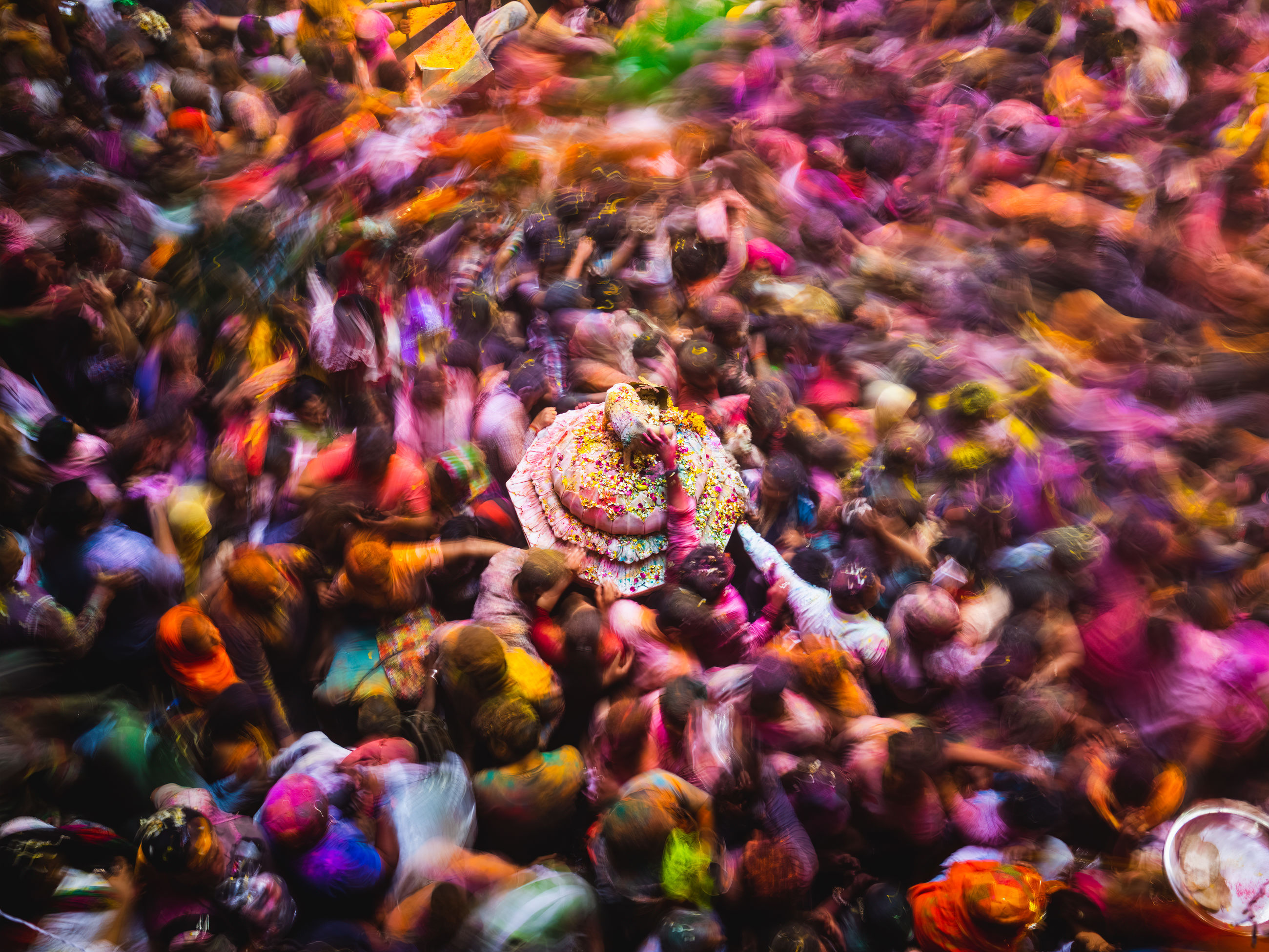 multi colored, group of people, crowd, blurred motion, motion, day, real people, large group of people, outdoors, high angle view, close-up, celebration, beauty in nature, full frame, nature, fragility, festival
