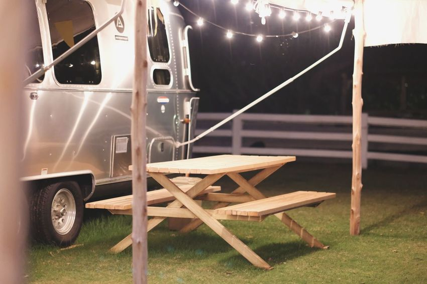 silber campervan with wood table in the front EyeEm Nature Lover EyeEm Selects Vintage Grass Green Homecar Campervan Motorhome Camping Forest EyeEm Best Shots Traveling Traveller Chill Campfire Grass Area Motor Home Camping Stove Sheep Field Grassland Agricultural Field