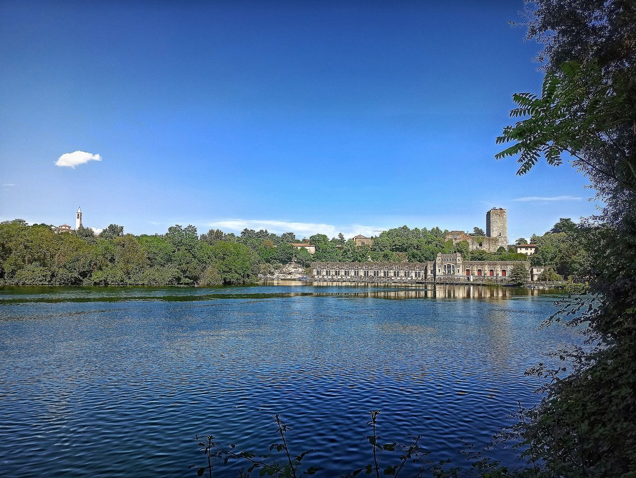 VIEW OF LAKE AGAINST BLUE SKY