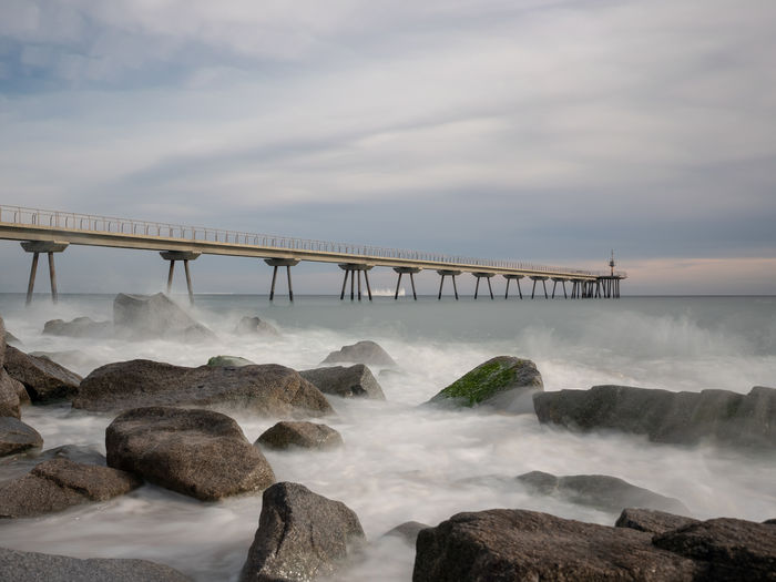 Water Motion Cloud - Sky Sea Long Exposure Sky Bridge Scenics - Nature Rock Beauty In Nature Bridge - Man Made Structure Connection Rock - Object Nature Solid Built Structure Architecture No People Flowing Water Power In Nature Outdoors Flowing Badalona Pontdelpetroli