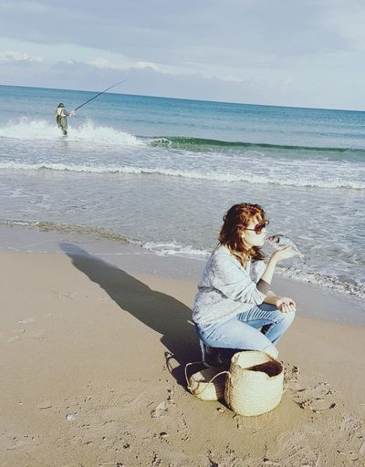 Hunting Beachphotography Sandy Beach Outdoor Photography Enjoying Life Hobbyphotography Hobby Fishing Boat Fisherman Fishing 50 Ways Of Seeing: Gratitude Water Young Women Full Length Sea Technology Beach Women Wireless Technology Sitting Sand Wave Surfing Seascape Calm Water Sport