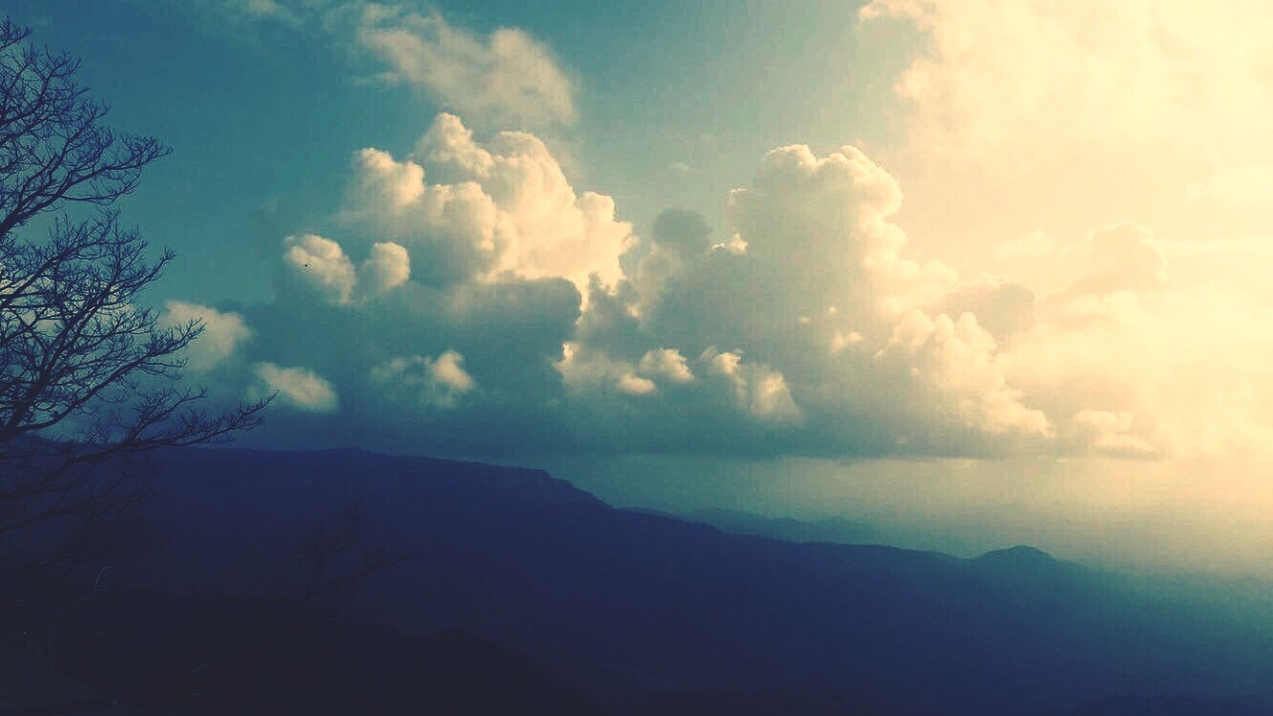 sky, scenics, tranquil scene, beauty in nature, tranquility, cloud, nature, cloud - sky, mountain, non-urban scene, outdoors, day, majestic, no people, cloudscape, solitude, remote, mountain range, cloudy