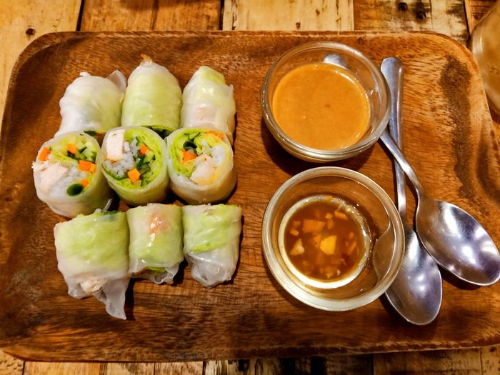 High angle view of spring rolls on table