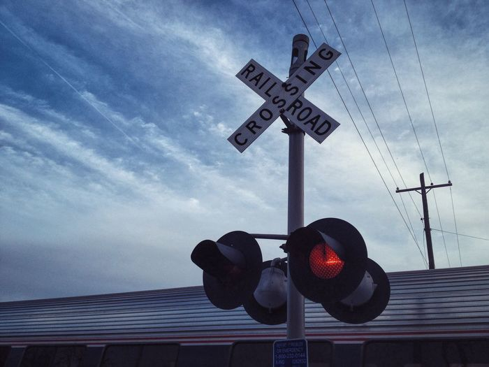 Railroad Crossing Sky Crossing Sign Road Sign Outdoors Clouds Train Railroad Lines The Week On EyeEm