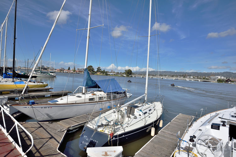 Alameda Marina & Shipyard 4 Oakland/Alameda Estuary Historic Waterfront Marina Harbor Moored Boats Sailboats Masts Sky And Clouds Wet Berths Dock Dock Side Yachts Nautical Vessels Jet Skies Estuary Office Buildings Warehouses Boat Launch