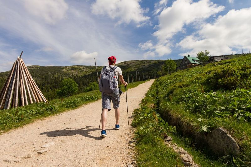 Tourist on a hike Panorama Scenic Scenery Hillside Hill Man Traveler Travel Summer Mountains Tourism Walk Path Hiker Hike Trail Hiking Trekking Full Length Cloud - Sky One Person Outdoors Day One Man Only Sky Men People Standing Nature Young Adult