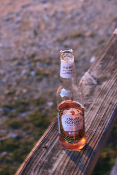 Alcohol Beer Bottle Bottle Close-up Container Day Drink Focus On Foreground Food And Drink Glass - Material Healthcare And Medicine High Angle View Nature No People Outdoors Refreshment Selective Focus Transparent Wine Bottle Wood - Material