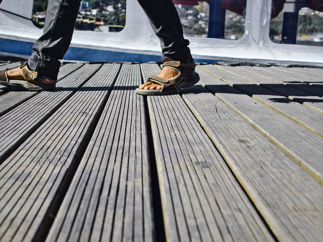 Waiting at the dock Adult Adults Only Bench Close-up Day Dock Human Body Part Human Leg Human Limb Limb Lines And Shapes Low Section Men Only Men Outdoors People Real People Shoe Togetherness Two People Walking Wood