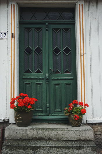 old beauiful door in Gamlebyen Closed Door Flower Window Architecture Built Structure Building Exterior Safety Day House Outdoors No People Doors Stairs Gamlebyen GamlebyenFredrikstad Fredrikstad
