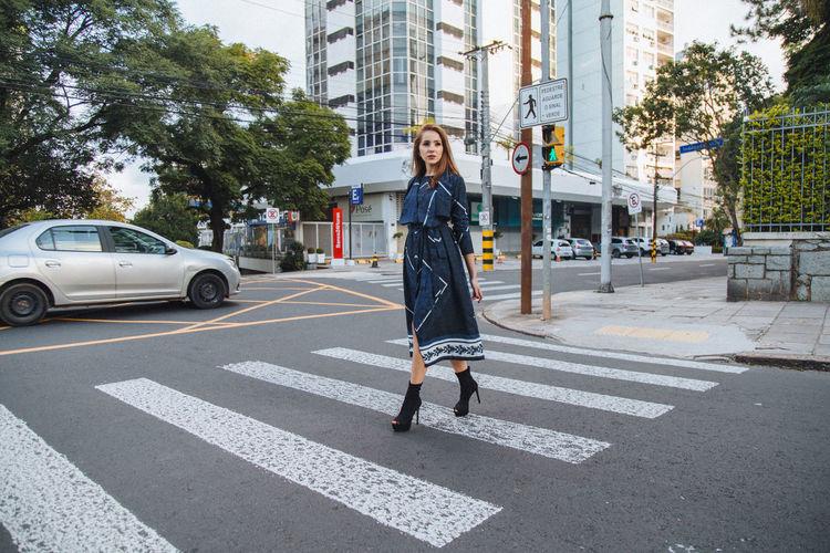 Full Length Of Woman Crossing Road