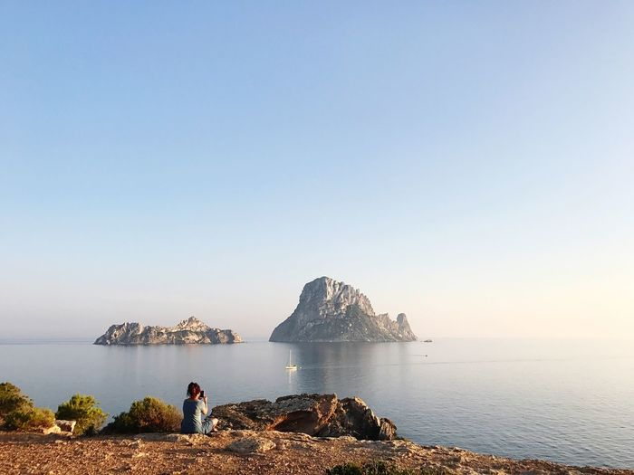 EyeEm Selects Sea Clear Sky Rock - Object Nature One Person Horizon Over Water Ibiza Es Vedrá Full Length Tranquility Tranquil Scene Beauty In Nature Scenics Sky Copy Space Blue Standing Real People Outdoors Leisure Activity Lifestyles Lost In The Landscape