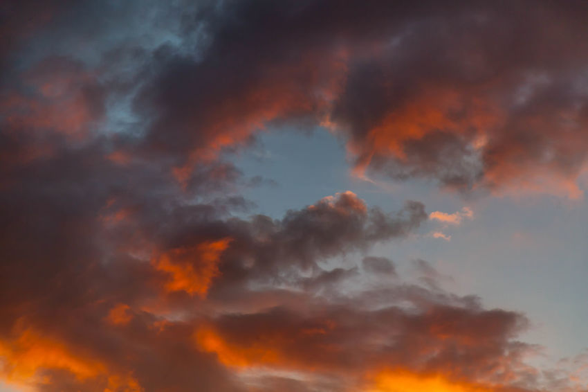 Colorful Clouds at Sunset Backgrounds Beauty In Nature Cloud Cloud - Sky Cloudscape Cloudy Dramatic Sky Full Frame Idyllic Low Angle View Majestic Moody Sky Multi Colored Nature No People Orange Color Outdoors Overcast Scenics Sky Sky Only Sunset Tranquil Scene Tranquility Weather