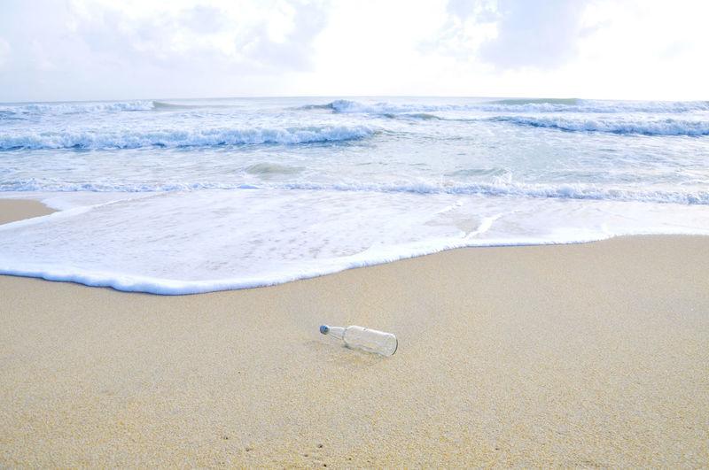 Abandoned bottle on shore