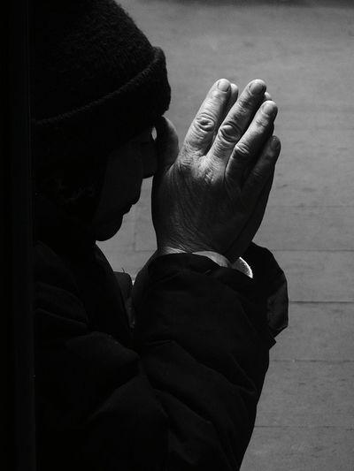 Close-up of nun praying