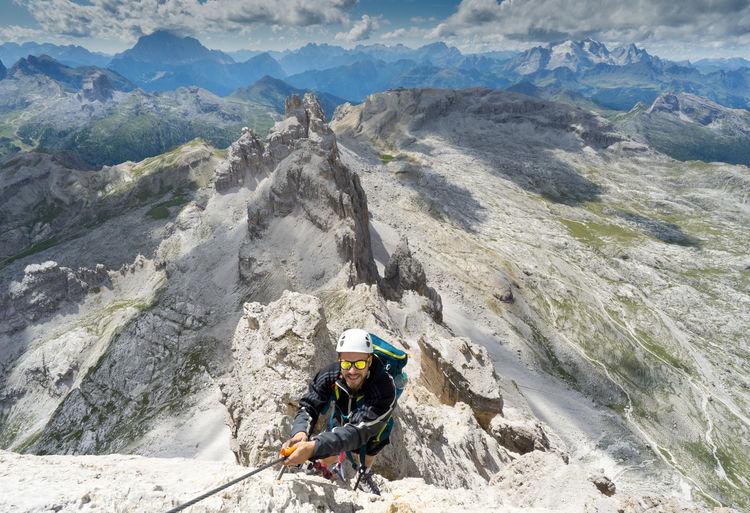 High angle view of man hiking on mountain