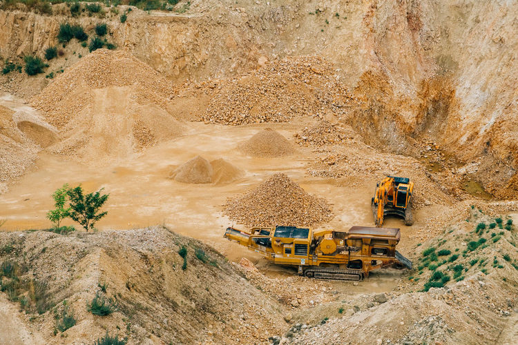 Minerals Bulldozer Commercial Land Vehicle Construction Industry Construction Machinery Construction Site Construction Vehicle Dirt Earth Mover Environment Equipment Geology Industry Land Vehicle Landscape Machinery Mine Mining Mode Of Transportation Quarry Stone Surface Mine Transportation Truck Vehicle