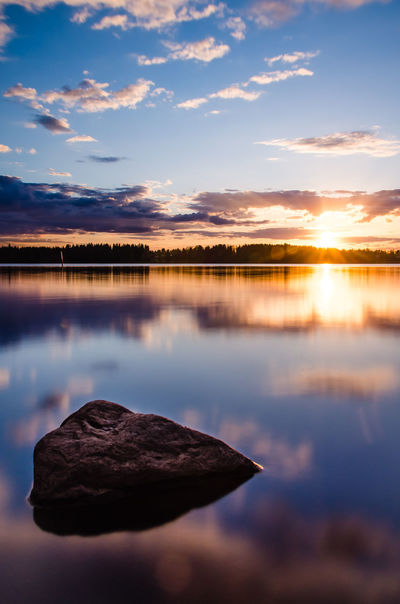 Lonely rock at the sunset Beauty In Nature Day Daylight Filter Forrest Lake Landscape Long Exposure Nature ND Filter No People Outdoors Reflection Rock Sky And Clouds Smooth Water Stone Sunny Sunrise Sunset Travel Water Lost In The Landscape Perspectives On Nature