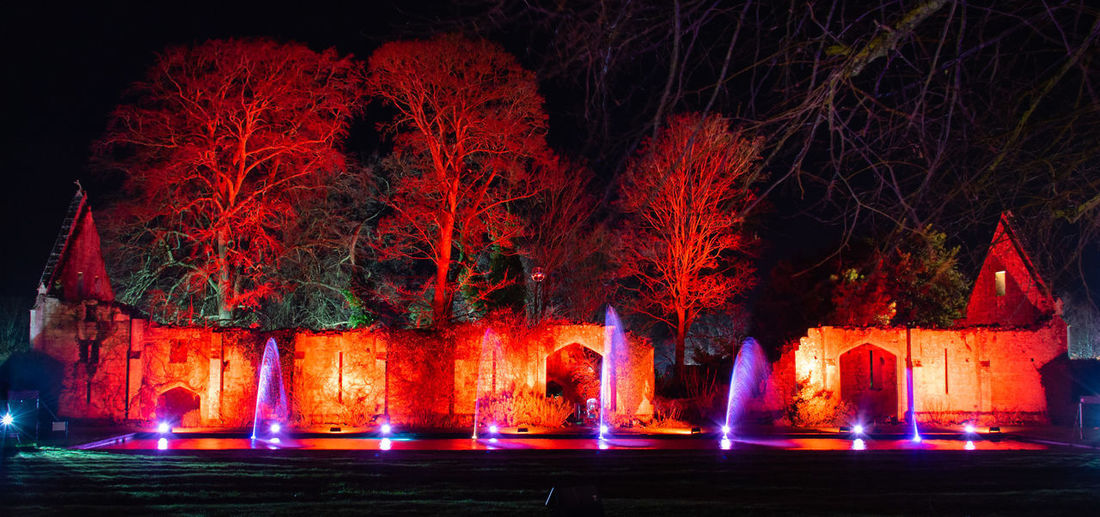 Illuminated Night Glowing Orange Color Water Long Exposure Fountain Spectacle Of Light Sudeley Castle