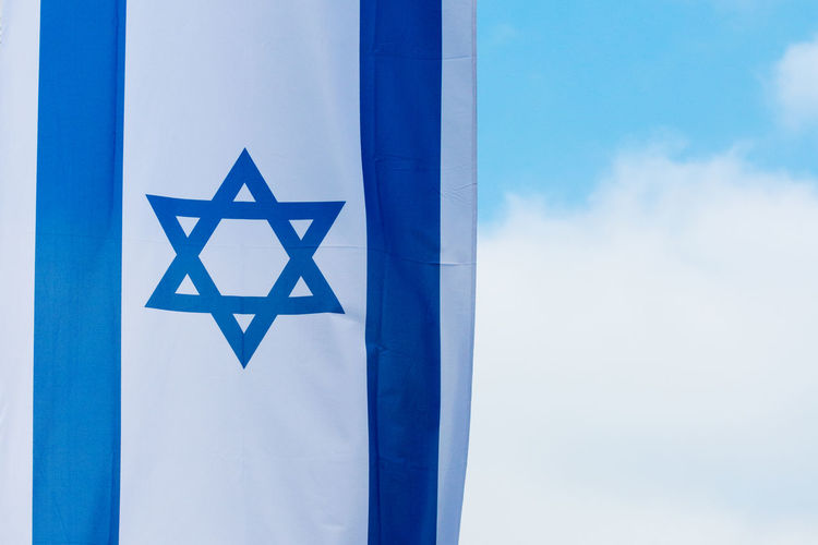 Blue No People Sky Day Shape Cloud - Sky Star Shape Outdoors Close-up Low Angle View Design White Color Copy Space Flag Nation Flag Israel Flag Of Israel David Star Proud Pride Patriotism Israelian Flag Symbol Jewish