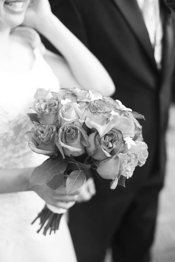 Close-up of woman holding rose bouquet