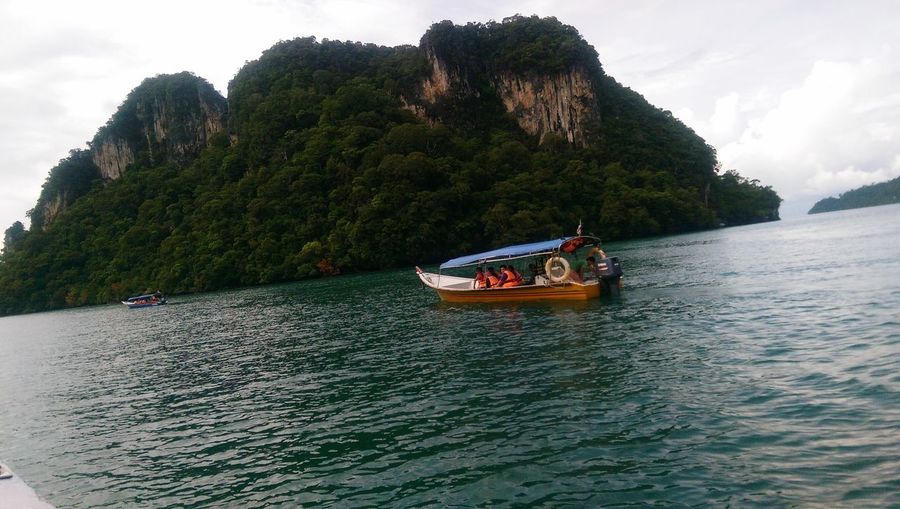 Boat Long Boat Langkawi Nautical Vessel Water Transportation Mode Of Transportation Tree Plant Sky Nature Beauty In Nature Sea Waterfront Day Outdoors Travel Scenics - Nature