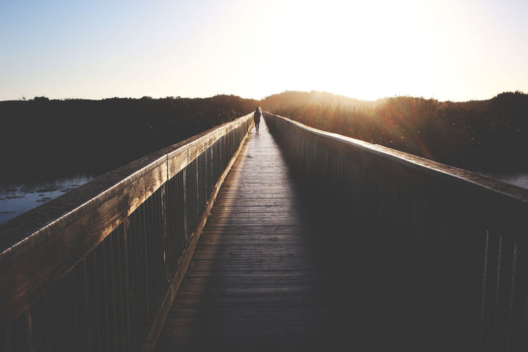 Beauty In Nature Boardwalk Bridge - Man Made Structure Bright Clear Sky Connection Day Diminishing Perspective Nature Outdoors Railing River Scenics Sky Straight Sun Sunbeam Sunlight Sunny The Way Forward Tranquil Scene Tranquility Vanishing Point Water