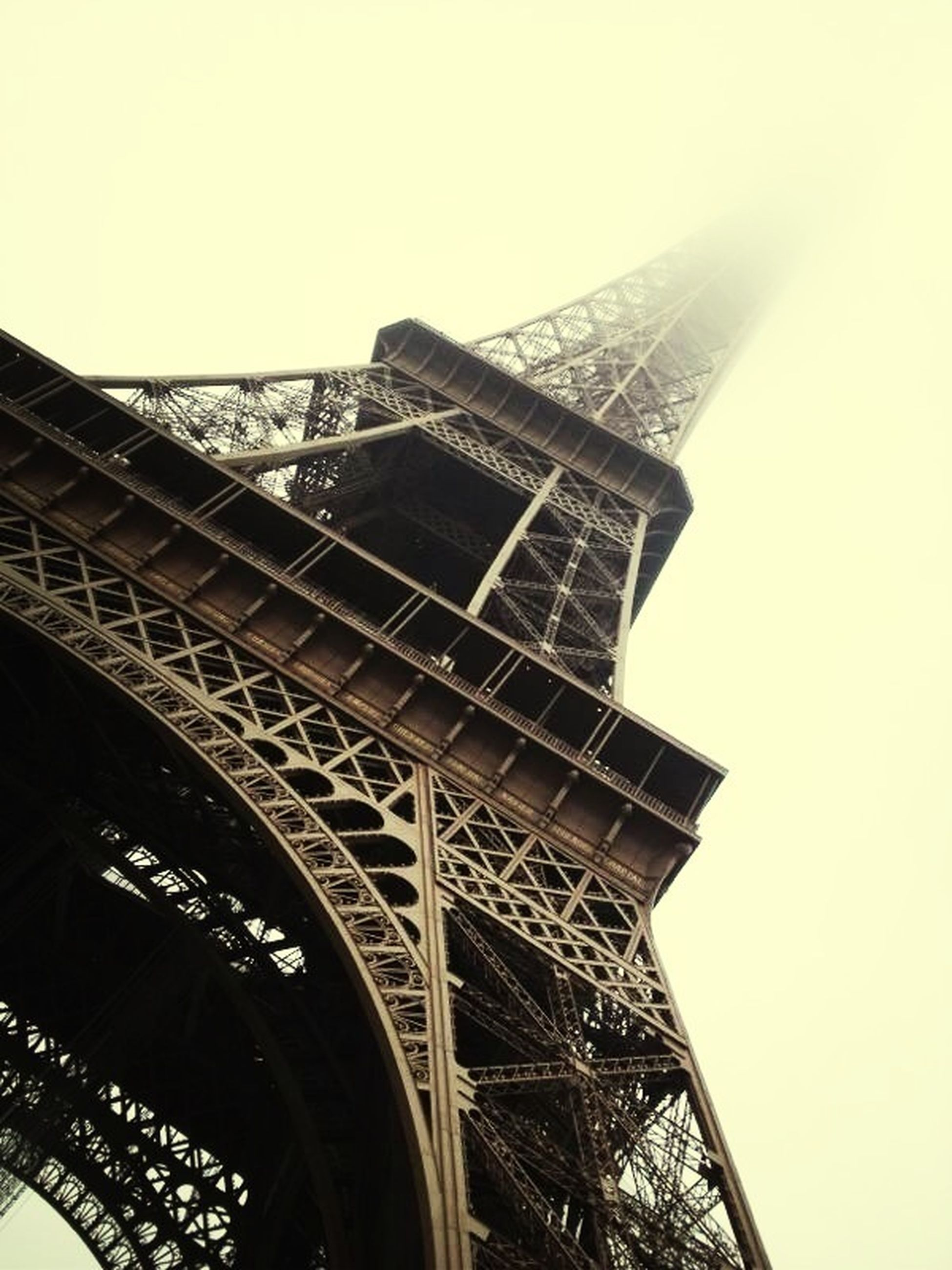 architecture, built structure, low angle view, clear sky, building exterior, tower, famous place, travel destinations, eiffel tower, international landmark, capital cities, history, culture, tall - high, tourism, metal, travel, city, architectural feature, sky