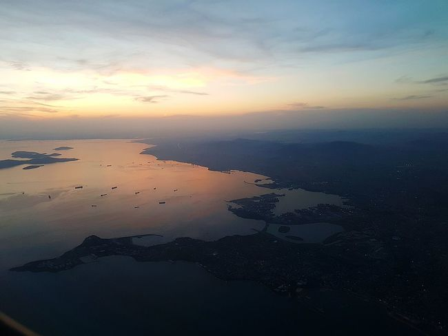 City Space Water Sea Sunset Airplane Aerial View Mountain Horizon Blue