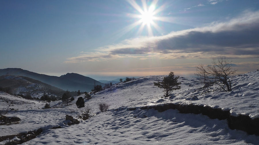 Scenic view of snow covered mountains against sky