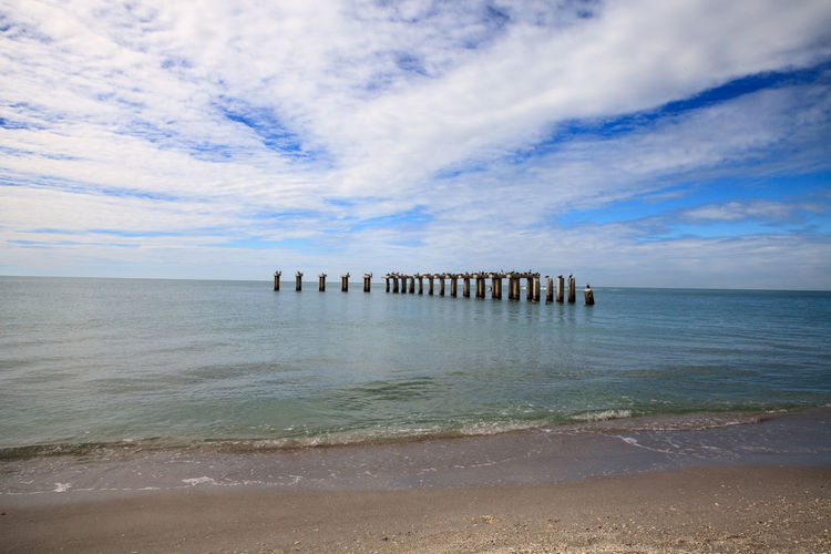 Old abandoned stone fishing pier called bocahenge is l shaped and found in boca grande