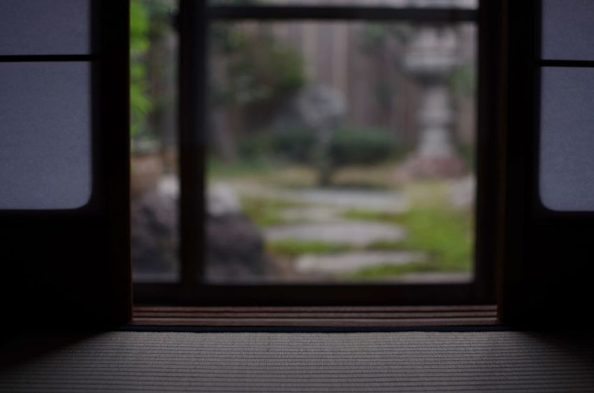 Early morning light reveals a peaceful garden behind a Japanese home. Window No People Door Entrance Japanese Home Japanese Garden Early Morning Japan Architecture Soft Light Selective Focus Peaceful Tranquility Morning Calm